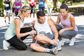 Man with injured ankle during race in park — Stock Photo