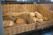 Baskets with breads freshly baked and tongs — Stock Photo