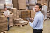 Warehouse manager working on tablet pc — Stock Photo