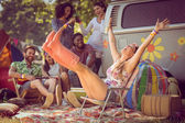 Carefree hipster having fun on campsite — Stock Photo