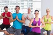 People practicing tree pose in fitness studio — Stock Photo