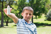 Little boy showing his inhaler — Stock Photo