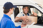 Delivery driver handing parcel to customer — Stock Photo