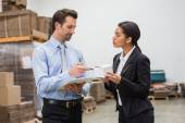 Focused warehouse managers working together — Stock Photo