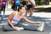 Fit woman warming up before race — Stock Photo
