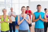 People meditating with hands joined in fitness club — Stock Photo