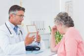 Doctor talking to tensed patient — Stock Photo