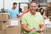 Smiling volunteer man taking notes — Stock Photo