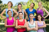 Fitness group smiling at camera in park — 图库照片