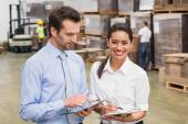 Smiling warehouse managers working — Stock Photo