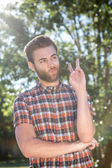 Happy hipster showing peace sign — Foto Stock
