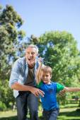 Father and son having fun in park — Stock Photo