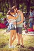 Hipster couple smiling and hugging — Stock Photo