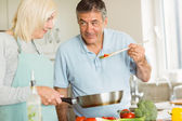 Mature couple making dinner together — Stock Photo