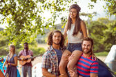 Pretty hipster on friends shoulders — Stock Photo