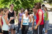 Runners chatting after race in park — Stock Photo