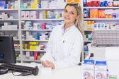 Pharmacist holding medicines looking at camera — Stock Photo