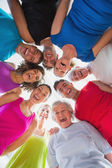 Cheerful people forming huddle at gym — Stock Photo