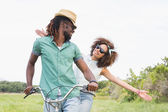 Young couple on a bike ride — Stock Photo