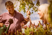Happy mature couple gardening together — Stock Photo