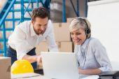 Warehouse managers using laptop — Stock Photo