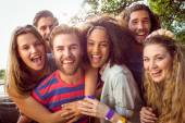 Happy hipsters smiling at camera — Stock Photo