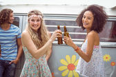 Pretty hipsters toasting with beer — Stock Photo