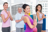 Friends with hands clasped standing in gym — Stock Photo