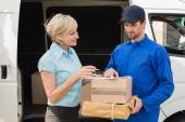 Delivery driver showing where to sign — Stock Photo