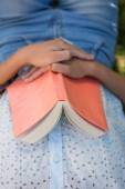 Woman napping in park with book — Stock Photo