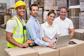 Warehouse managers and worker — Stock Photo
