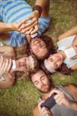 Hipsters lying on grass smiling — Stock Photo
