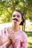 Pretty brunette with fake mustache — Stock Photo
