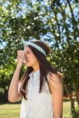 Pretty brunette using her inhaler — Stock Photo