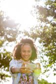 Pretty hipster using her smartphone — Stock Photo