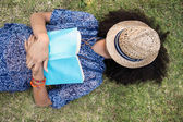 Pretty young woman napping in park — Stock Photo