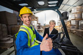 Warehouse worker and manager smiling — Stock Photo