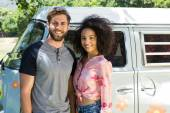 Hipster couple beside their van — Stock Photo