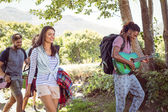 Friends walking towards their campsite — Stock Photo