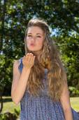 Pretty blonde blowing a kiss — Stock Photo