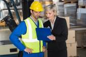 Forklift driver talking with manager — Stock Photo