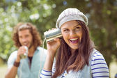 Couple shouting through tin cans — Stock Photo