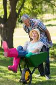 Couple playing with wheelbarrow — Stock Photo