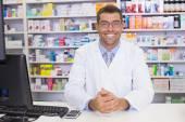 Smiling pharmacist looking at camera — Stock Photo