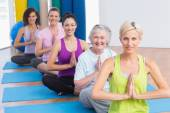Women meditating with hands joined during fitness class — Stock Photo