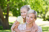 Happy blonde with her daughter — Stock Photo