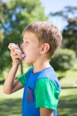 Little boy using his inhaler — Stock Photo