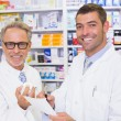 Pharmacist looking medication for prescription — Stock Photo #69010367