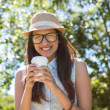 Pretty brunette having coffee to go — Stock Photo #69010497