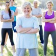 Happy athletic group with arms crossed — Stock Photo #69010893